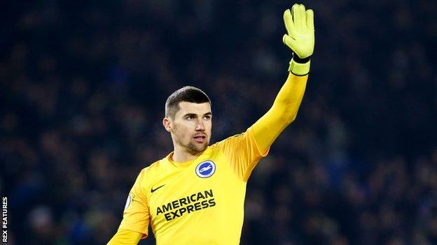 Brighton goalkeeper Mat Ryan waves to acknowledge the crowd after a draw against Arsenal