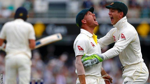 Australia's David Warner celebrates with Tim Paine after catching Jake Ball