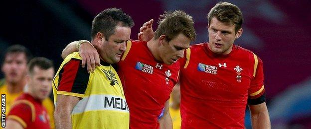 Liam Williams is helped off the field against Australia