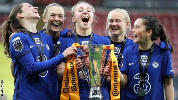 Niamh Charles celebrating winning the League Cup this season