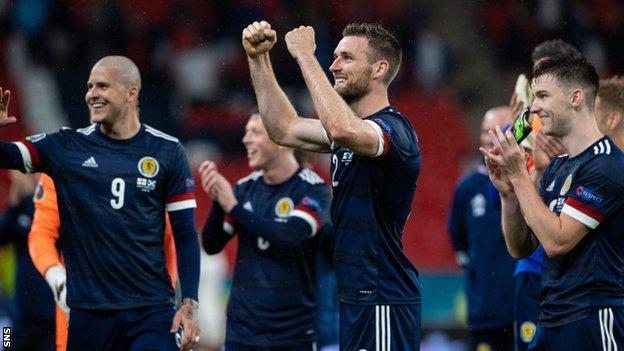 Scotland's Stephen O'Donnell (centre) and Kieran Tierney celebrate