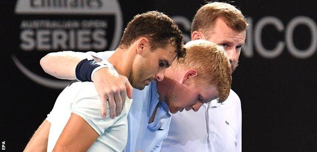 Grigor Dimitrov comes to Kyle Edmund's aid after the Briton rolls his ankle in Brisbane