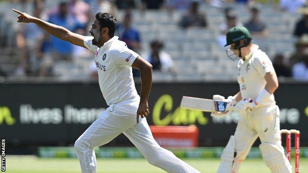 India spinner Ravichandran Ashwin (left) runs off in celebration after dismissing Australia batsman Steve Smith on day one of the second Test