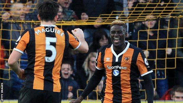 Alfred N'Diaye and Harry Maguire