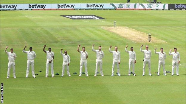 South African cricketers raise fists before match thumbnail