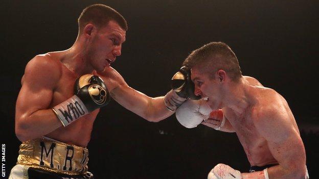 Liam Williams (left) punches Liam Smith