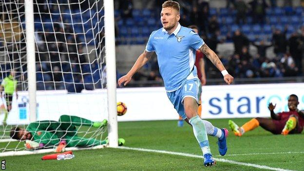 Lazio's Ciro Immobile celebrates after scoring against Roma