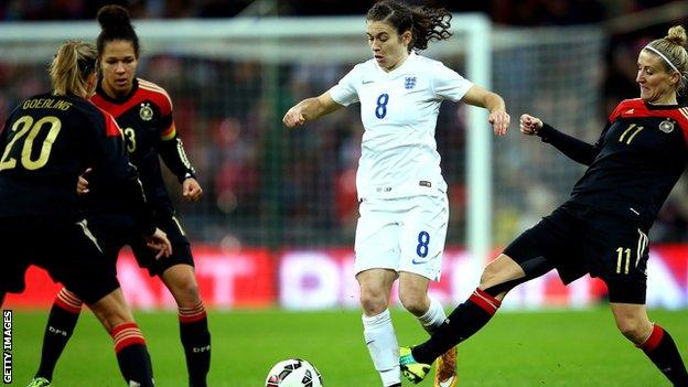 Karen Carney shields the ball from three Germany players