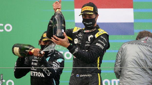 Daniel Ricciardo celebrates on the podium