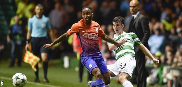 Kieran Tierney gets the ball away from Manchester City's Raheem Sterling
