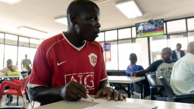 Man placing bet in Zimbabwe