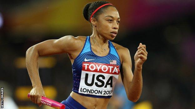 American sprinter Allyson Felix runs with a baton in the 4x400m relay final at the 2017 World Championships in London