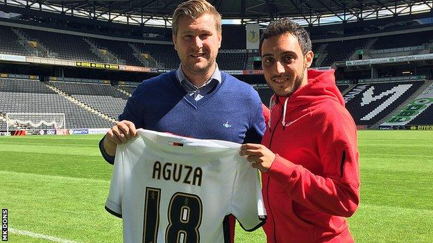 Sergio Aguza (right) with MK Dons boss Karl Robinson