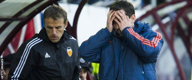 Gary Neville with brother and Valencia assistant coach Phil Neville