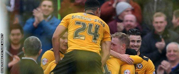 Newport celebrate taking the lead against Plymouth Argyle