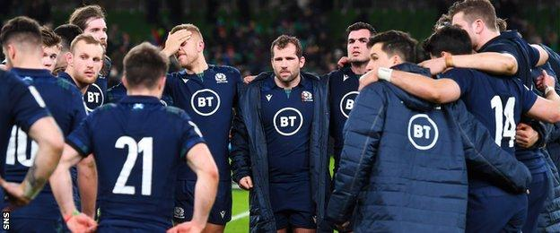 Fraser Brown at the centre of a Scotland team talk
