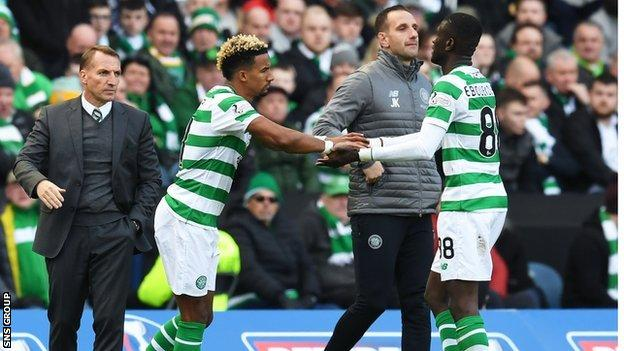 Eboue Kouassi (right) was replaced by Scott Sinclair after injuring his knee against Hearts in the League Cup