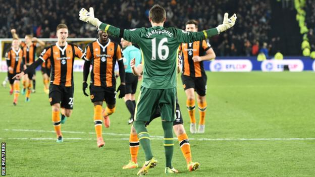 Hull's players rush to congratulate keeper Eldin Jakupovic after their victory over Newcastle