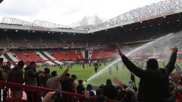 Fans protest on the pitch at Old Trafford