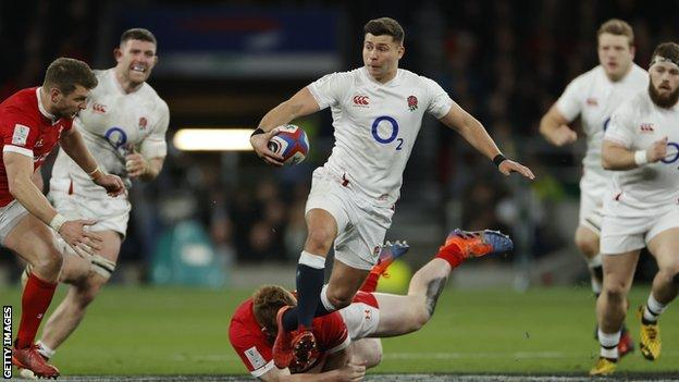 England's Ben Youngs steps out of a tackle
