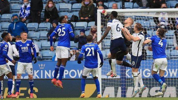 Kasper Schmeichel punches into his own net to give Tottenham an equaliser at King Power Stadium