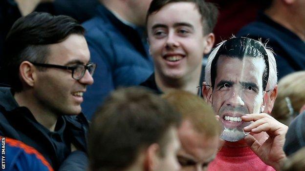 Fan wears Carlos Tevez mask (right)
