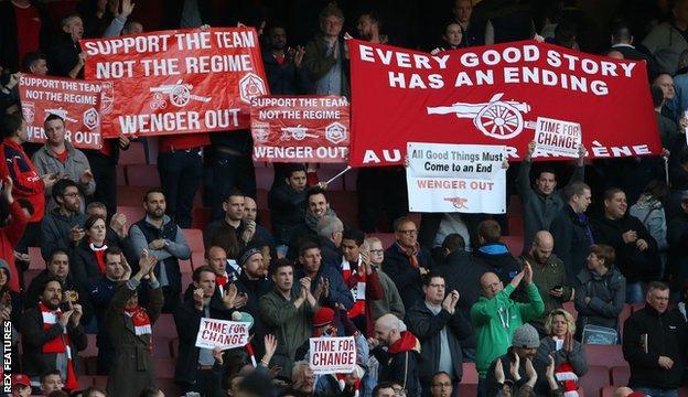 Fans inside the Emirates Stadium protesting against Wenger