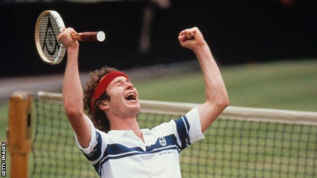 hollywood John McEnroe waves both hands in the air after winning the 1981 Wimbledon final
