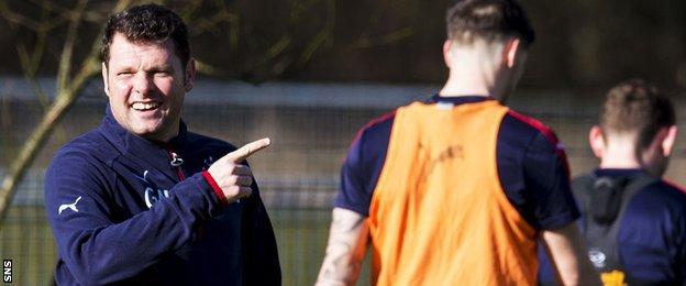 Rangers caretaker Graeme Murty shares a joke during Monday training