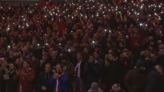 Lincoln fans paid tribute to Graham Taylor between the 75th and 76th minutes - marking the 1975-76 season when he led them to the Fourth Division title and the fourth round of the FA Cup