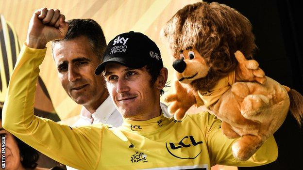 Geraint Thomas celebrates on the podium after the penultimate stage of the Tour de France
