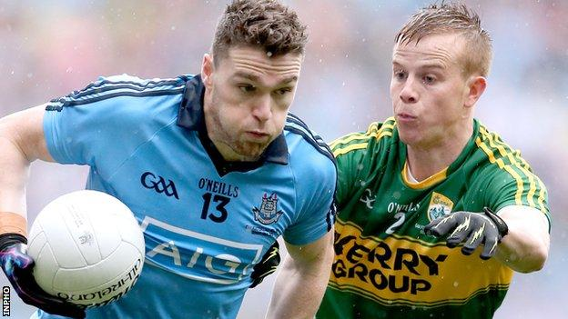 Paddy Andrews of Dublin in action against Kerry defender Fionn Fitzgerald