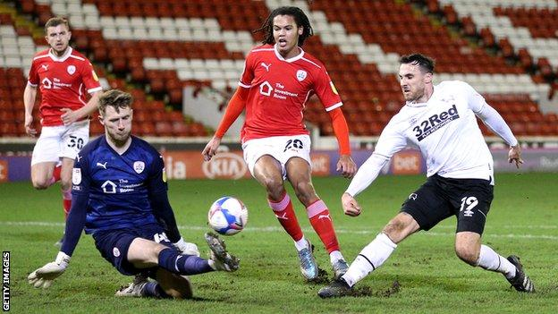 Lee Gregory shoots at goal for Derby against Barnsley
