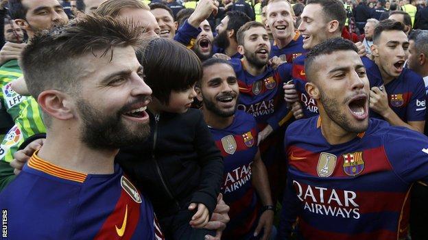Barcelona players celebrating winning La Liga