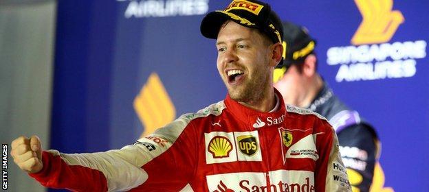 Sebastian Vettel celebrates winning in Singapore in 2015
