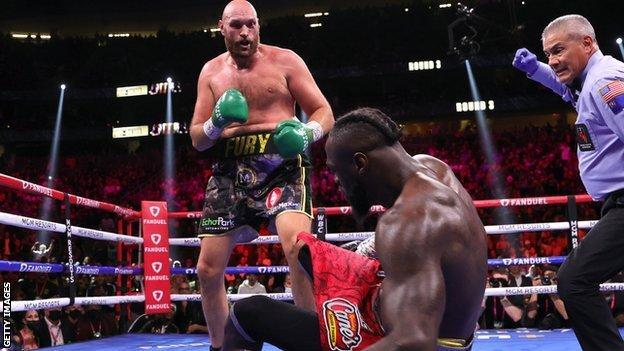 Tyson Fury knocks down Deontay Wilder