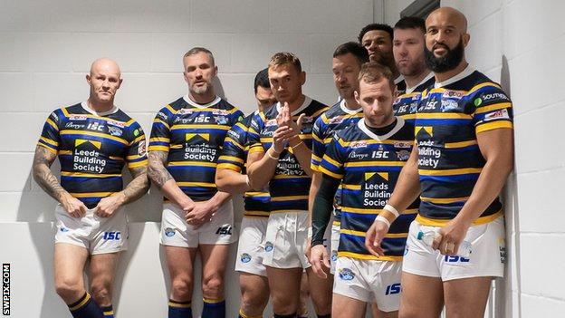 Kevin Sinfield and Rob Burrow wait with other ex-Leeds teammates to go on in the testimonial game