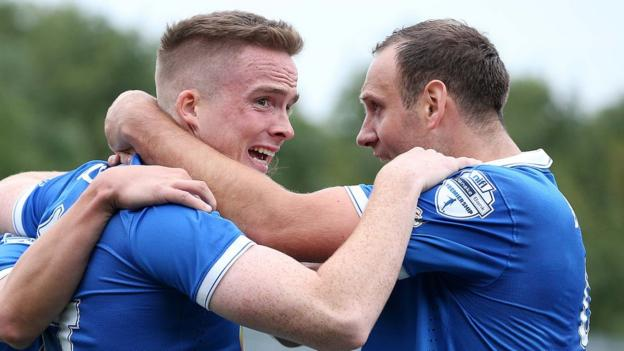 Linfield substitute Aaron Burns scored his side's third as the Premiership leaders drew 3-3 away to Cliftonville