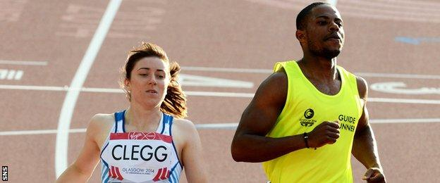 Libby Clegg and guide runner Mikail Huggins