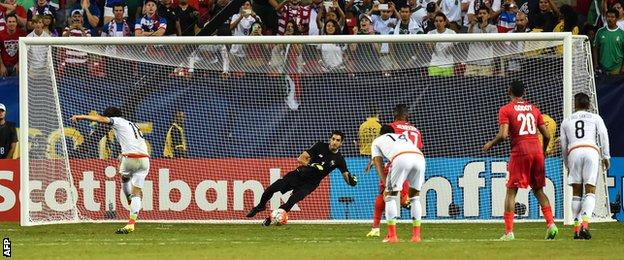 Mexico's Andres Guardado scores the winning penalty