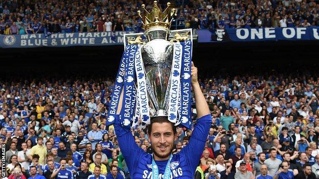 Eden Hazard lifts the 2016-17 Premier League trophy