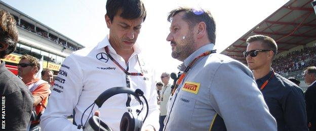 Toto Wolff, Executive Director (Business), Mercedes AMG, and Paul Hembery, Director, Pirelli Motorsport, on the grid.