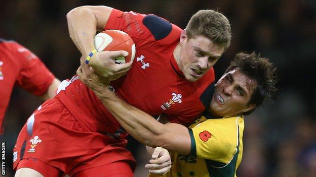 Rhys Priestland of Wales is tackled by Nick Phipps of Australia in November 2014