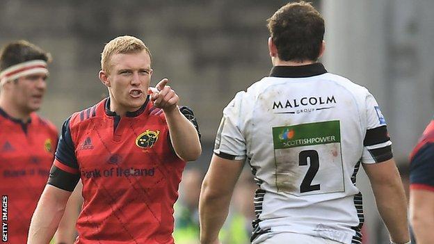 Munster's Keith Earls points the finger at Glasgow hooker Fraser Brown
