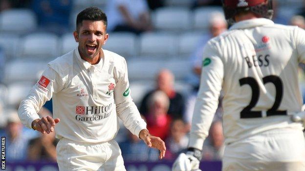 Lancashire's Keshav Maharaj celebrates a wicket at Taunton