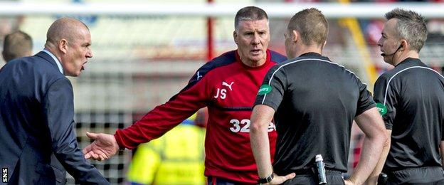 Rangers manager Mark Warburton and goalkeeping coach Jim Stewart remonstrate with the match officials at Pittodrie