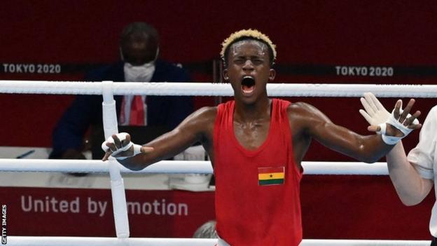Ghanaian boxer Samuel Takyi celebrates his quarter-final win at the Tokyo Olympics