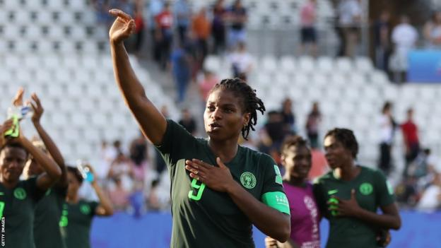 Nigeria's Desire Oparanozie waves to the crowd after a game at 2019 Women's World Cup