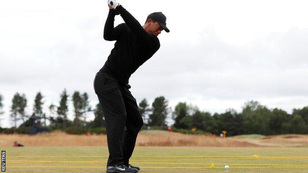 Tiger Woods taking a practice shot at Carnoustie