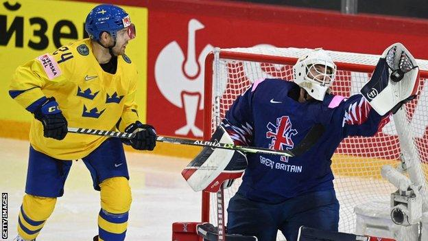 Ben Bowns saves another shot for Great Britain against Sweden at the Ice Hockey World Championships in Latvia